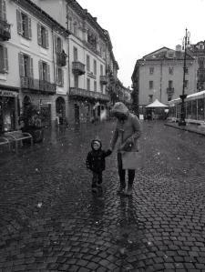 Abbie and Henry walking through the streets catching snowflakes